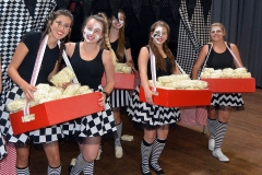 Reinette Jacobs, Kesia Pohl, Jenelle de Jonge, Anize Basson and Mia Naudé serving popcorn to the matrics.