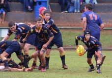 Carl Dohse (u.14) handles the ball, with Franco Pretorius and Wessel de Kock looking on.