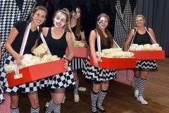 Reinette Jacobs, Kesia Pohl, Jenelle de Jonge, Anize Basson and Mia Naudé serving popcorn to the matrics.